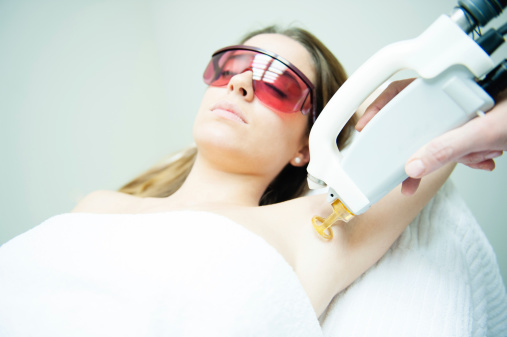 Girl receiving laser hair removal